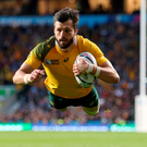Flying machine: Adam Ashley-Cooper scores his second try and Australia's third