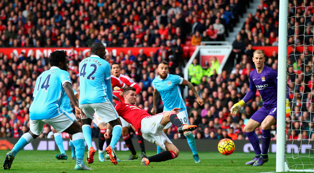 At a stretch: Morgan Schneiderlin just can't get a touch to divert the ball into the Man City net