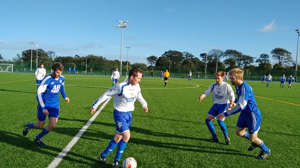 Action from Bangor Rangers v Annalong Swifts