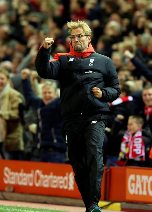 Boxing clever: Jurgen Klopp punches the air after Liverpool scored the opener at Anfield yesterday