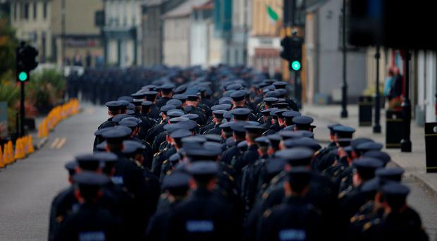The funeral procession of Garda Tony Golden passes through Blackrock village on its way to St Oliver Plunkett Church, Blackrock in Co Louth, for his state funeral. Pic Niall Carson/PA Wire