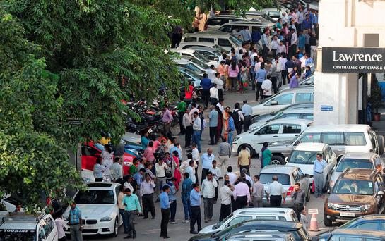 Indian office workers stand in an open area in a carpark following an earthquake in New Delhi on October 26, 2015. A strong earthquake lasting almost a minute was felt in New Delhi on October 26, with buildings shaking in the centre of the Indian capital. Tremors were also felt as far away as Islamabad in Pakistan and the Afghan capital Kabul, but not in neighbouring Nepal which was hit by a major quake in April. AFP PHOTO / PRAKASH SINGHPRAKASH SINGH/AFP/Getty Images