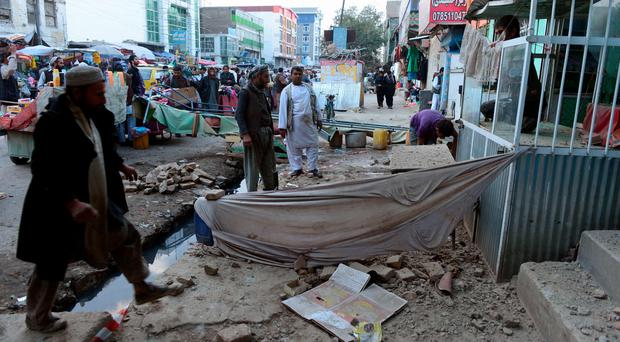 Afghan men remove debris after a powerful earthquake hit Kabul on October 26, 2015. A powerful 7.5 magnitude earthquake killed at least 74 people as it rocked parts of south Asia, including 12 Afghan girls crushed in a stampede as they fled their collapsing school. Hundreds more were injured as as the quake shook a swathe of the subcontinent, sending thousands of frightened people rushing into the streets in Afghanistan, Pakistan and India. AFP PHOTO / AREF KARIMIAref Karimi/AFP/Getty Images