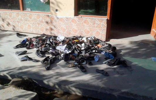 The abandoned shoes of Afghan schoolgirls involved in a deadly stampede are seen outside a school following an earthquake in Takhar Province on October 26, 2015. A powerful 7.5 magnitude earthquake killed at least 74 people as it rocked parts of south Asia, including 12 Afghan girls crushed in a stampede as they fled their collapsing school. Hundreds more were injured as as the quake shook a swathe of the subcontinent, sending thousands of frightened people rushing into the streets in Afghanistan, Pakistan and India. AFP PHOTOSTR/AFP/Getty Images