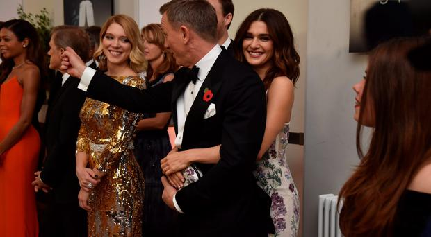 LONDON, ENGLAND - OCTOBER 26: Daniel Craig and wife Rachel Weisz attend The Cinema and Television Benevolent Fund's Royal Film Performance 2015 of the 24th James Bond Adventure,
