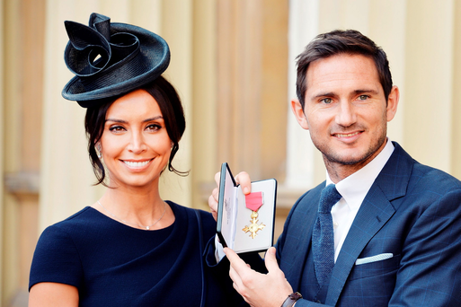 Frank Lampard with partner Christine Bleakley as he holds his Officer of Order of the British Empire (OBE) medal.