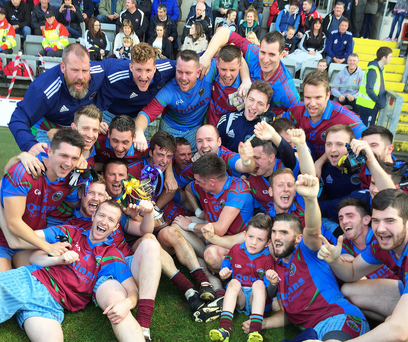 Prize guys: St Mary's, Glasdrumman players celebrate clinching the Down Junior title after beating Ardglass in the showpiece to remain the only unbeaten side in the Mourne County