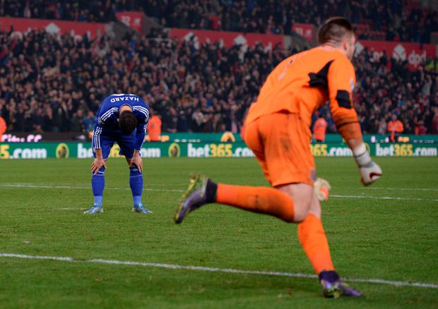 Down and out: Stoke City goalkeeper Jack Butland celebrates after saving the crucial penalty from Chelsea's Eden Hazard at the Britannia Stadium
