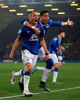 Leon Osman Everton celebrates scoring his side's first goal with team-mate Ramiro Funes Mori