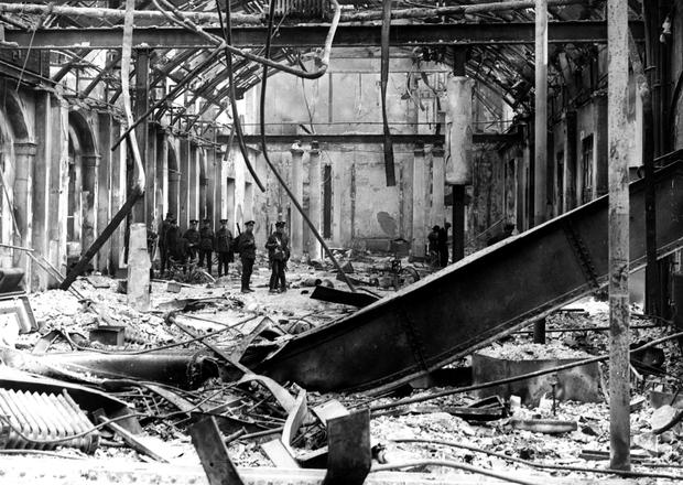 GPO in ruins 1916: Soldiers survey the interior of the post pffice in Sackville Street, Dublin, during the Easter Rising of 1916. (Photo by Hulton Archive/Getty Images)