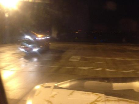 Emergency services met the plane as it arrived at the international airport. Pic Justin Hames.