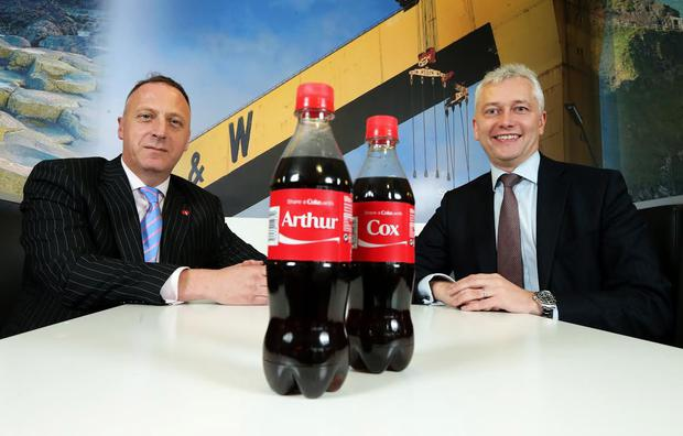 Raymond McGinley (L), Legal Director at Coca-Cola HBC, and Alan Taylor (R), Managing Partner at Arthur Cox's Belfast office, celebrate the appointment of Arthur Cox as legal adviser to Coca-Cola HBC on an all-Ireland basis