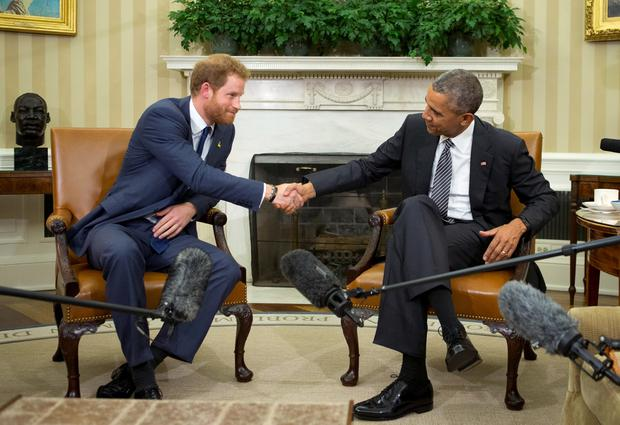President Barack Obama and Britains Prince Harry, left, shake hands during their meeting in the Oval Office of the White House in Washington, Wednesday, Oct. 28, 2015. Prince Harry is in the United States working on preparations for the Invictus Games, which will take place in Orlando, Fla., in May 2016. (AP Photo/Manuel Balce Ceneta)