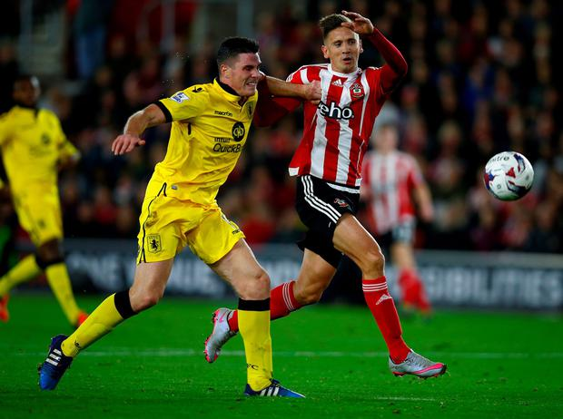 SOUTHAMPTON, ENGLAND - OCTOBER 28: Ciaran Clark of Aston Villa challenges Gaston Ramirez of Southampton during the Capital One Cup Fourth Round match between Southampton v Aston Villa at St Mary's Stadium on October 28, 2015 in Southampton, England. (Photo by Mike Hewitt/Getty Images)