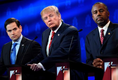 Republican Presidential hopefuls (L-R) Marco Rubio, Donald Trump, and Ben Carson look on during the CNBC Republican Presidential Debate. (ROBYN BECK/AFP/Getty Images)