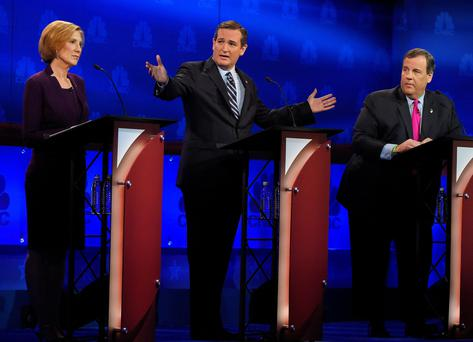 Ted Cruz, center, talks about the mainstream media as Carly Fiorina, left, and Chris Christie look on during the CNBC Republican presidential debate at the University of Colorado (AP Photo/Mark J. Terrill)