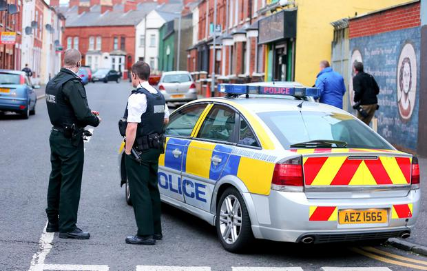 Police at the scene of attack in the Hawthorn Street area of Belfast. Picture - Kevin Scott / Presseye