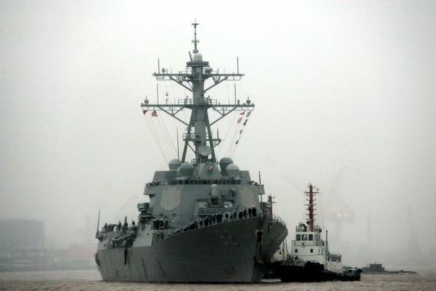 In this April 8, 2008, file photo, guided missile destroyer USS Lassen arrives at the Shanghai International Passenger Quay in Shanghai, China, for a scheduled port visit. Just two days after the USS Lassen sailed past one of China's artificial islands in the South China Sea in a challenge to Chinese sovereignty claims, (AP Photo/Eugene Hoshiko, File)
