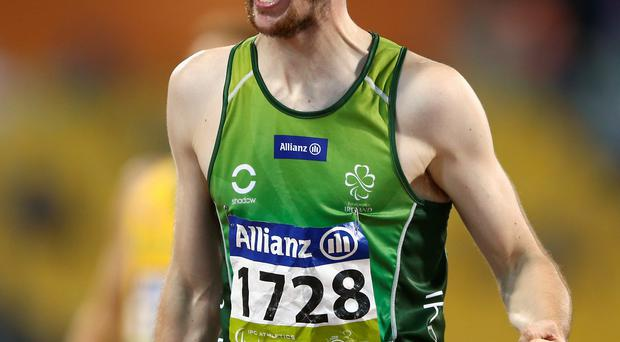 Golden run: Michael McKillop celebrates after his victory in the T37 1500 metres at the World Championships in Doha