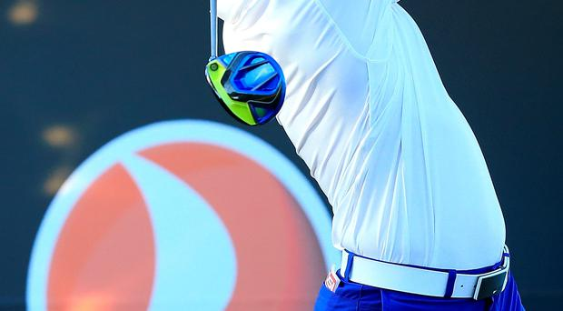 Four behind: Rory McIlroy shot a second successive 67