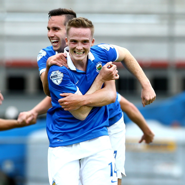 Swift reunion: Aaron Burns, left with Andy Waterworth, is one of Linfield's golden boys and this afternoon he will come up against his twin brother and Dungannon Swifts ace Andrew