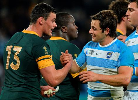 South Africa's centre Jesse Kriel (L) greets Argentina's fly half and captain Nicolas Sanchez after the bronze medal match of the 2015 Rugby World Cup between South Africa and Argentina. AFP PHOTO / GLYN KIRK