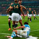First blood: JP Pietersen (14) celebrates scoring his side's first try with team-mate Handre Pollard