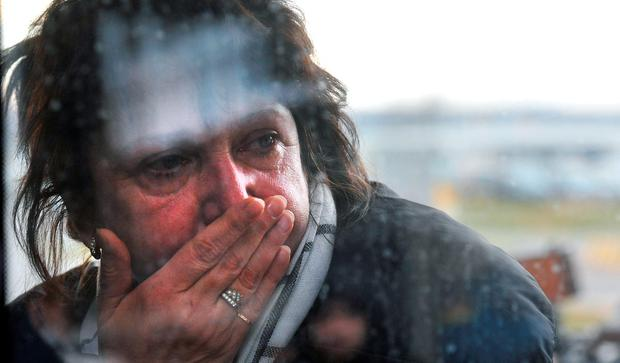 A relative reacts at Pulkovo international airport outside Saint Petersburg after a Russian plane with 224 people on board crashed in a mountainous part of Egypt's Sinai Peninsula on October 31, 2015. AFP/Getty Images