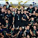 New Zealand's Richie McCaw lifts the World Cup trophy as New Zealand celebrate winning the Rugby World Cup Final at Twickenham, London. PRESS ASSOCIATION