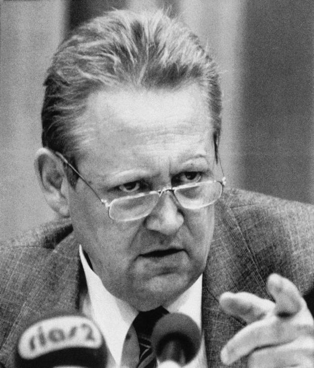 East German politburo member Guenter Schabowski announces that those who want to visit other countries and then return would still need a visa, but that visa requests would be handled without delay, during a news conference in East Berlin. (AP Photo/Lutz Schmidt, file)