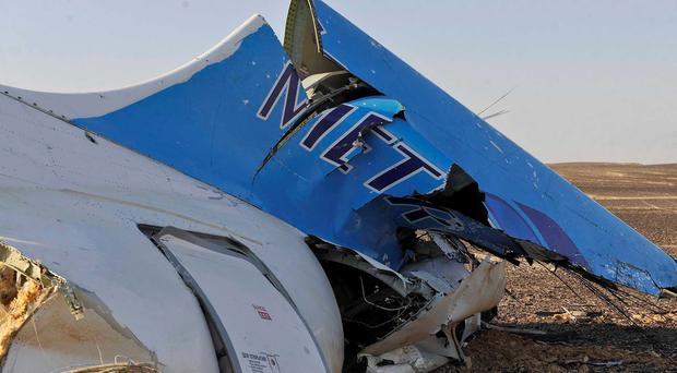 The tail of a Metrojet plane that crashed in Hassana, Egypt on Saturday, Oct. 31, 2015. (Suliman el-Oteify/Egyptian Prime Minister's Office via AP)