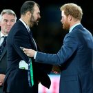 So close: Michael Cheika, the head coach of Australia, is consoled by Prince Harry after Saturday's loss