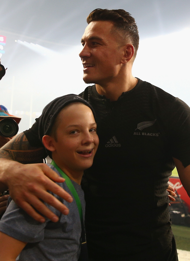 Classy touch: Sonny Bill Williams, who handed his winners medal to fan Charlie Lines, wil remain a force in midfield