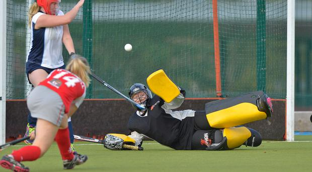 Damage done: Kate McConnell fires a shot beyond North Down goalkeeper Trish Neill