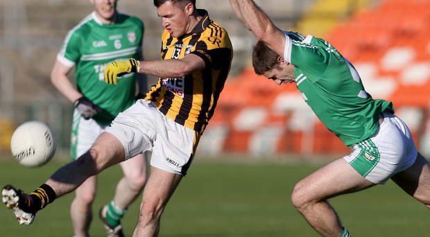 Closed down: Cargin's Kevin O'Boyle is put under pressure at the Athletic Grounds INPHO