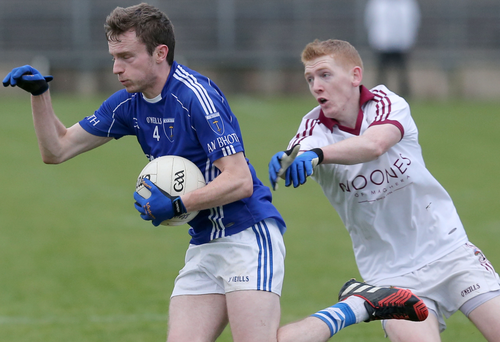 Race is on: Scotstown's Shane Carey is pursued by Slaughtneil's Karl McKaigue