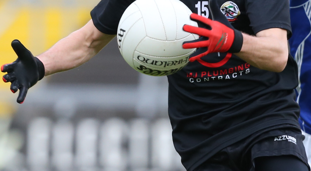 Big impact: Conor Laverty battles for Kilcoo