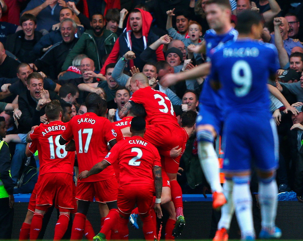 Red alert: Liverpool players celebrate against Chelsea