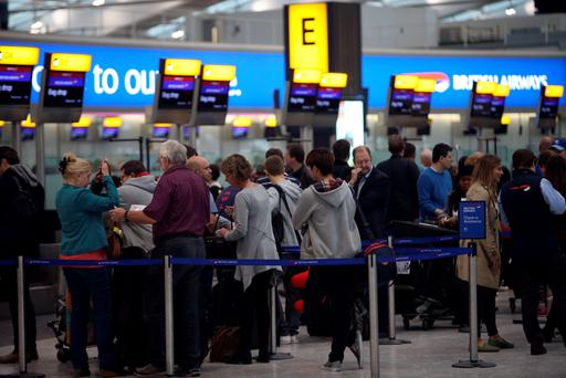Passengers queue inside Terminal 5 of Heathrow Airport, as thick fog was disrupting flights at UK airports for a second day.