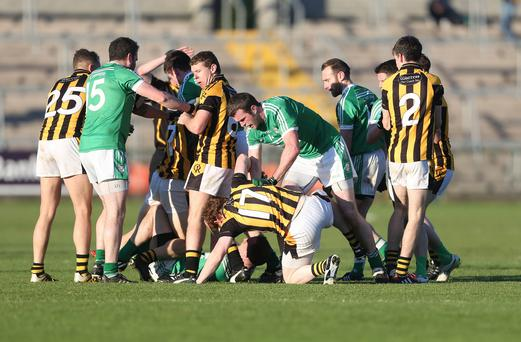 Ugly scenes: Tempers flare at Sunday's clash between Crossmaglen Rangers and Cargin after an alleged biting incident