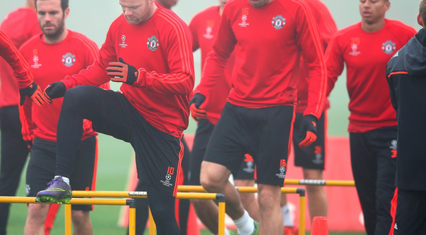 Gloomy forecast: Wayne Rooney leads his Manchester United team mates in training ahead of their clash with CSKA Moscow