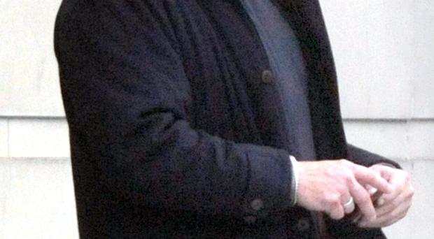 Bryan Thomas Stronge, aged 53, whose address in court was given as c/o Tennent Street PSNI station, leaves Belfast Crown Court this afternoon after pleading guilty to stealing £52,000 from the Northern Ireland Court Service. He will be sentenced in December.