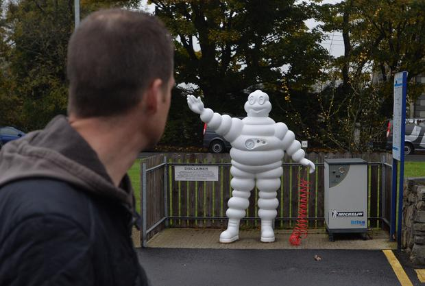 Workers leave the Michelin tyre factory in Ballymena yesterday after news that the factory will close in 2018 with the loss of 860 jobs
