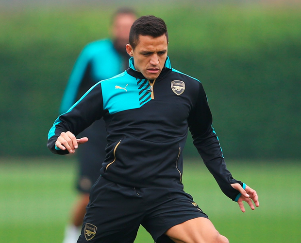 Close control: Arsenal's Alexis Sanchez in training ahead of the Gunners' Champions League trip to Bayern Munich
