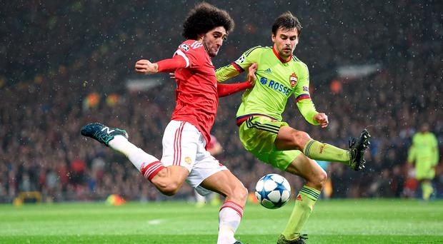 CSKA Moscow's Georgi Schennikov (right) attempts to block the cross from Manchester United's Marouane Fellaini during the UEFA Champions League match at Old Trafford, Manchester. PRESS ASSOCIATION Photo. Picture date: Tuesday November 3, 2015. See PA story SOCCER Man Utd. Photo credit should read: Martin Rickett/PA Wire