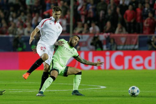 Sevilla's Fernando Llorente, left and Manchester City's Gael Clichy challenge for the ball during the Group D Champions League soccer match between Sevilla and Manchester City at the Ramon Sanchez-Pizjuan stadium in Seville, Spain, Tuesday Nov. 3, 2015. (AP Photo/Miguel Angel Morenatti)