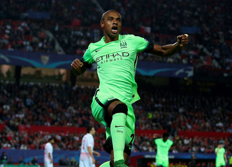 Jumping for joy: Fernandinho shows his delight after netting City's second goal against Sevilla
