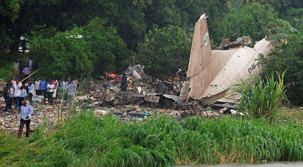 People gather at the site where a cargo plane crashed into a small farming community on a small island in the White Nile river, close to Juba airport in the Hai Gabat residential area. (Charles Lomodong/AFP/Getty Images)