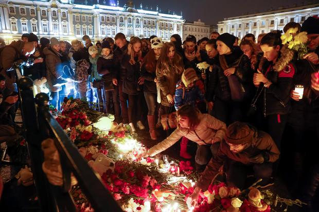 People light candles during a day of national mourning for the plane crash victims at Dvortsovaya Square in St Petersburg, Russia. (AP Photo/Dmitry Lovetsky)