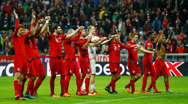 Bayern players acknowledge the fans after winning 5-1 during the Champions League Group F soccer match between Bayern Munich and Arsenal FC in Munich, southern Germany, Wednesday, Nov. 4, 2015. (AP Photo/Matthias Schrader)